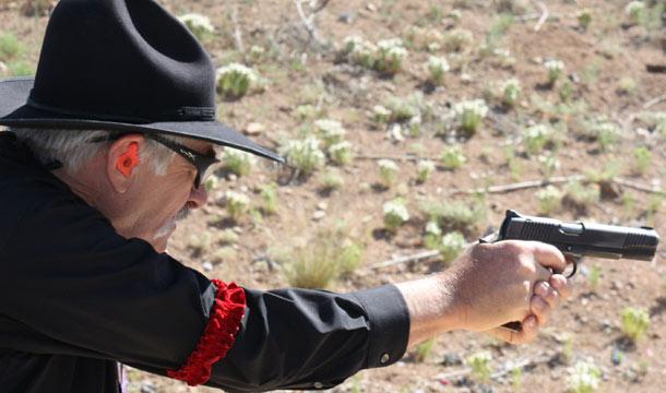 Evil Roy Shooting his 1911 in Wild Bunch